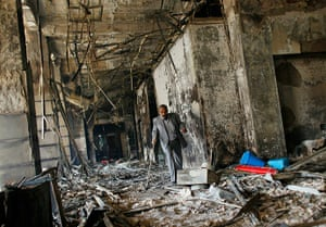 egypt protests continue: burned government building in Cairo
