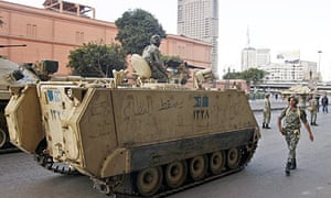 Egyptian soldiers with armoured vehicles patrol near the Egyptian Museum in Cairo