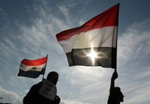 Egypt protests: Demonstrators in Tahrir Square wave Egyptian flags