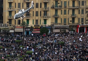 Egypt protests: A helicopter flies over protesters in Tahrir square
