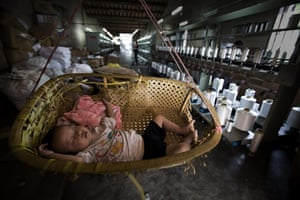 Industrial pollution: Baby in a Factory in Gurao, Shantou, Guangdong, China