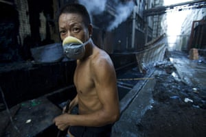 Industrial pollution: Factory Worker in Xintang, Zengcheng, Guangdong, China