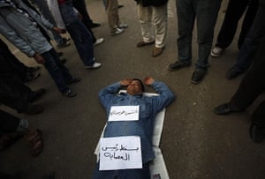 Egypt uprising: A protester sleeps at Tahrir Square in Cairo