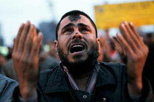 Egypt uprising: An anti-government protester cries during prayers in Tahrir Square