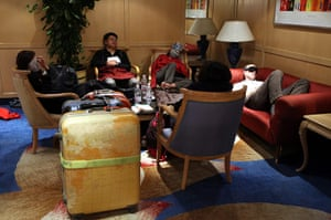 Egypt uprising: Foreign tourists sleep in the lobby of a hotel near the airport
