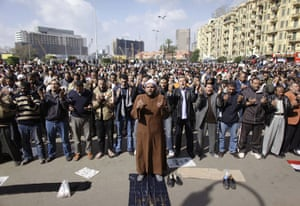 Egypt uprising: People pray in Tahrir Square