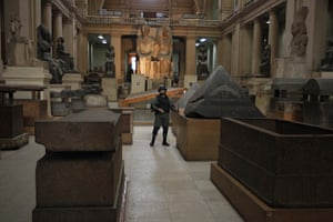 Egypt uprising: A member of the Egyptian special forces stands guard in the Egyptian Museum