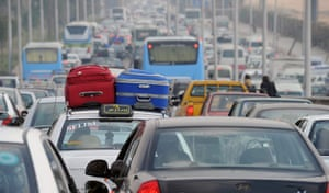 Egypt uprising: Cars in a traffic jam as they try to reach Cairo airport