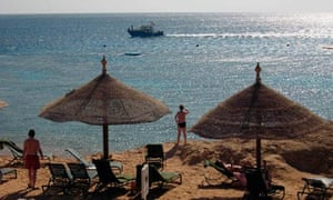 Tourists sunbathe in the Red Sea resort of Sharm el-Sheikh, Egypt