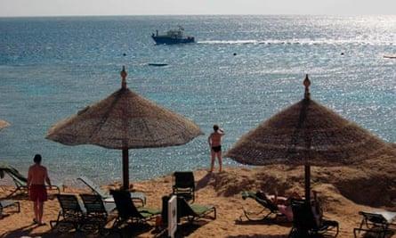 Tourists sunbathe in the Red Sea resort of Sharm el-Sheikh, Egypt