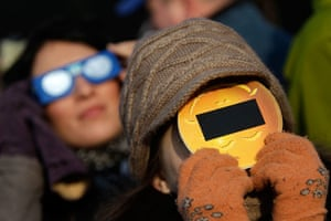 eclipse: People wear protective eyewear during partial solar eclipse in Bucharest