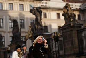 eclipse: A young woman observes a partial solar eclipse in Prague