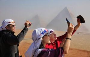 eclipse: Venezuelan tourists watch a partial solar eclipse in Egypt