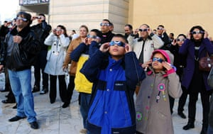 eclipse: People observe the partial solar eclipse in Tunis