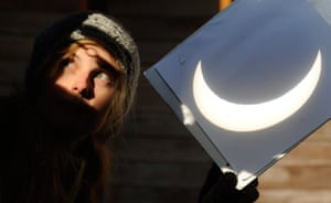 eclipse: Employee of the Stefanik Observatory in Prague uses a projection shield