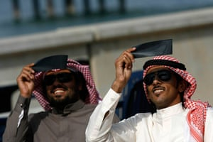 eclipse: Kuwaiti men look through special filters at a partial solar eclipse