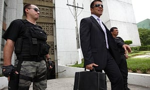 Amazon anti-narcotics judge Mauro Antony, with his security detail from the elite Fera squad