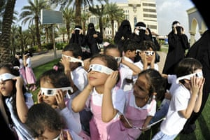 eclipse update: Saudis wear special tinted glasses to watch a partial solar eclipse