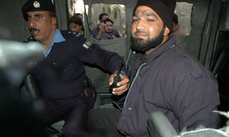 Malik Mumtaz Hussain Qadri after being arrested at the site of a fatal attack on Salman Taseer