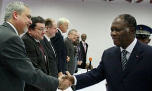 Alassane Ouattara, right, Ivory Coast's president-elect, meets with ambassadors