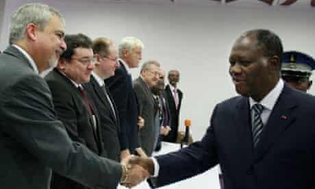 Alassane Ouattara, right, Ivory Coast's president-elect, meets with ambassadors