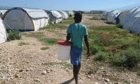 A young Haitian walks through a makeshift camp near Port-au-Prince