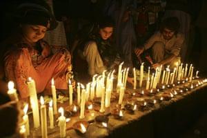 Salman Taseer Funeral: Members of Pakistan's Women Action light candles