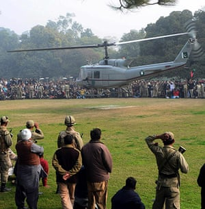 Salman Taseer Funeral: A helicopter carrying the coffin of Pakistan's Punjab governor departs