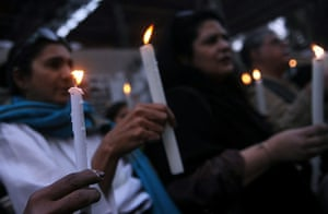 Salman Taseer Funeral: Pakistani activists and supporters of Salman Taseer hold lit candles