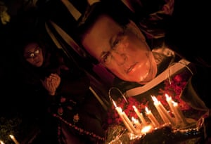 Salman Taseer Funeral: Pakistani women light candles and pray at the site of shooting