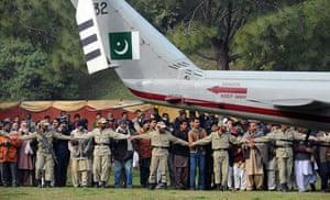 Salman Taseer Funeral: Pakistan paramilitary soldiers act as a human barrier