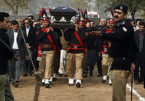 Salman Taseer Funeral: Pakistani police guards carry the coffin of the late Salman Taseer