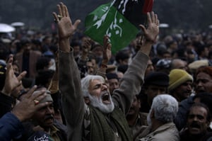Salman Taseer Funeral: A Pakistani mourner reacts during the funeral procession of Salman Taseer