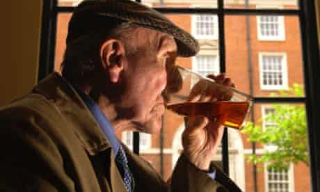 Old man drinking pint of beer