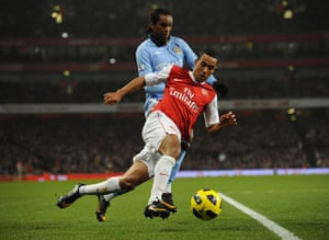 Arsenal v Manchester City: Manchester City's Jo keeps an eye on Theo Walcott