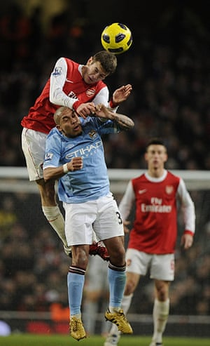 Arsenal v Manchester City: Wilshere beats De Jong in the air