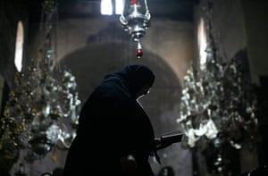 Orthodox Christmas: A Russian nun prays during Orthodox Christmas in the Church of the Nativity