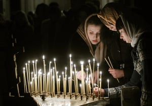 Orthodox Christmas: Lithuanian Orthodox Church believers light candles during the liturgy