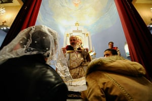 Orthodox Christmas: Parishioners receive communion in Los Angeles