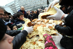 Orthodox Christmas: Christian Serb Orthodox believers share a traditional Christmas bread