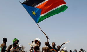 A south Sudanese woman waves the region's flag during a rally in favour of secession