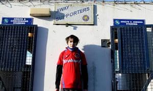 Torquay v Carlisle: A Carlisle United fan waits by the closed turnstiles