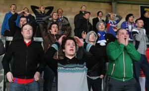 Torquay v Carlisle: Carlisle United fans show a look of dejection