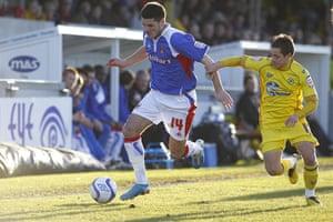 Torquay v Carlisle: Carlisle's Ben Marshall and Torquay's Danny Stevens battle for the ball