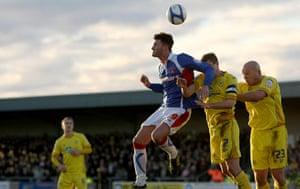 Torquay v Carlisle: Carlisle's Danny Stevens beats Torquay's Frank Smiek to the ball