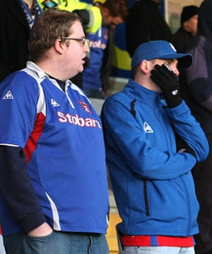 Torquay v Carlisle: A Carlisle United supporter yawns