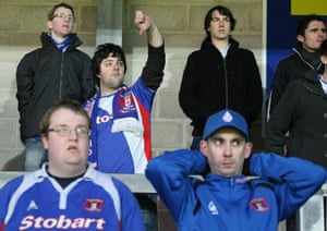 Torquay v Carlisle: Carlisle United fans show a look of dejection after their Cup exit