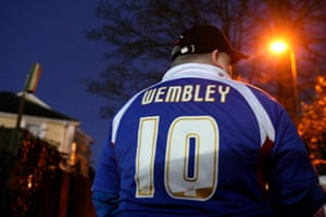 Torquay v Carlisle: A Carlisle United supporter with 'Wembley' on the back of his shirt