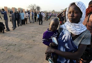 Sudan referendum: Southern Sudanese people queue to vote at a polling station in Juba