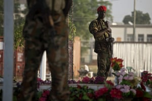 Sudan referendum: Southern Sudanese soldiers guard the tomb of the late leader Dr John Garang